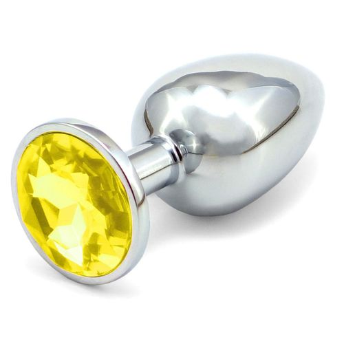 Větší anální kovový kolík se žlutým krystalem